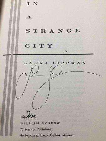IN A STRANGE CITY. by Lippman, Laura.