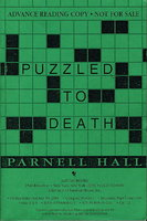 PUZZLED TO DEATH. by Hall, Parnell.