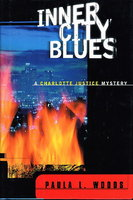 INNER CITY BLUES: A Charlotte Justice Novel. by Woods, Paula L