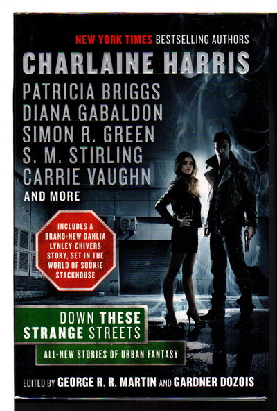 DOWN THESE STRANGE STREETS. by [Anthology, signed] Martin, George R.R. and Gardner Dozois; Joe Lansdale, signed.