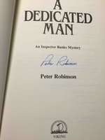 A DEDICATED MAN. by Robinson, Peter.