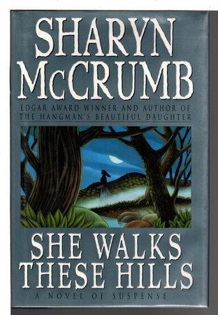 SHE WALKS THESE HILLS. by MCCrumb, Sharyn.
