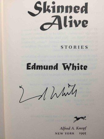 SKINNED ALIVE. by White, Edmund.