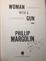 WOMAN WITH A GUN. by Margolin, Phillip.