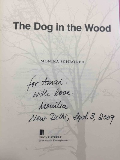 THE DOG IN THE WOOD. by Schroder, Monika.