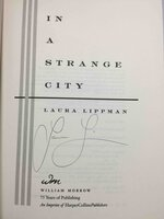 IN A STRANGE CITY. by Lippman, Laura.