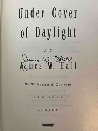 UNDER COVER OF DAYLIGHT. by Hall, James W.