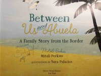 BETWEEN US AND ABUELA: A Family Story from the Border. by Perkins, Mitali. Sara Palacios, illustrator.
